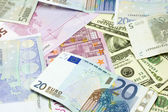 Dollar and euro banknotes — Стоковое фото