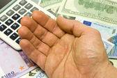 Dollar, euro banknotes, calculator, human hand — Stock Photo