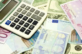 Dollar, euro banknotes, calculator — Stock Photo