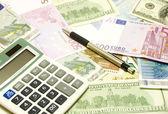Dollar, euro, lat banknotes, calculator, pen — Stockfoto