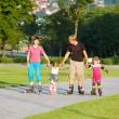 Family skating — Stock Photo
