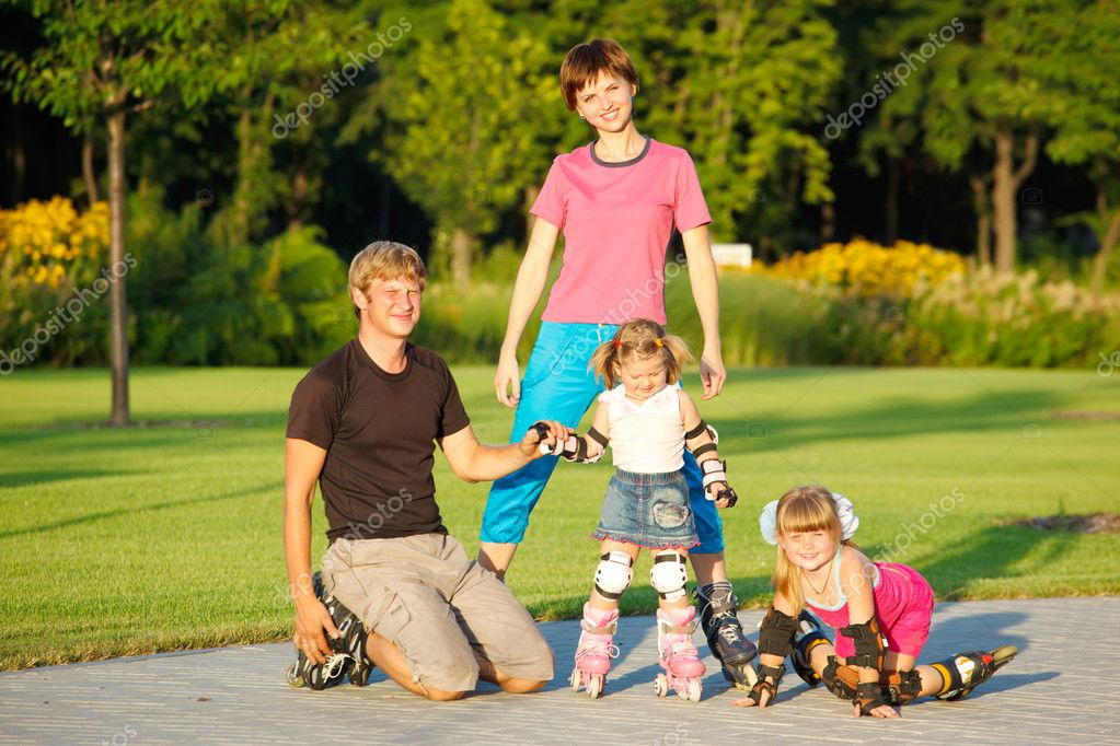 A happy family in roller skates  Stock Photo #3521020