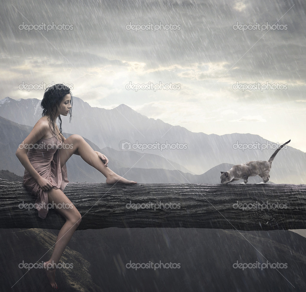 Young woman and cat on a trunk — Stock Photo #3211235