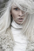 Portrait of a beautiful girl wearing white fur — Stock Photo