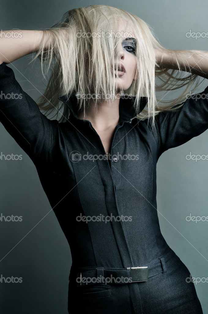 Young blonde in a vampire look — Stock Photo #3357396