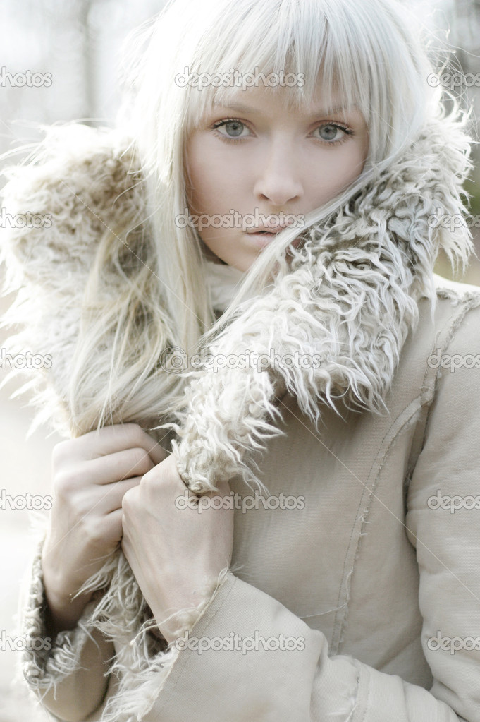 Portrait of a beautiful girl wearing white fur — Stock Photo #3357408