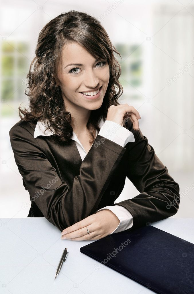 A modern portrait of a young professional businesswoman with pen, window in the background — Stock Photo #3357704