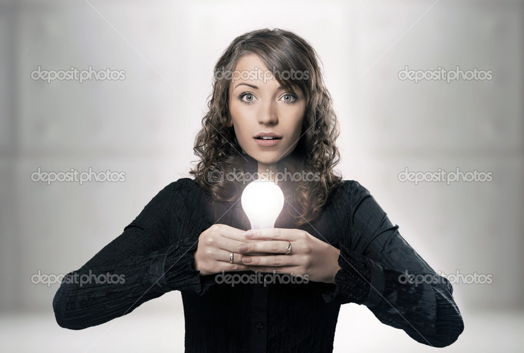 Young girl holding a light bulb  Stock Photo #3357713