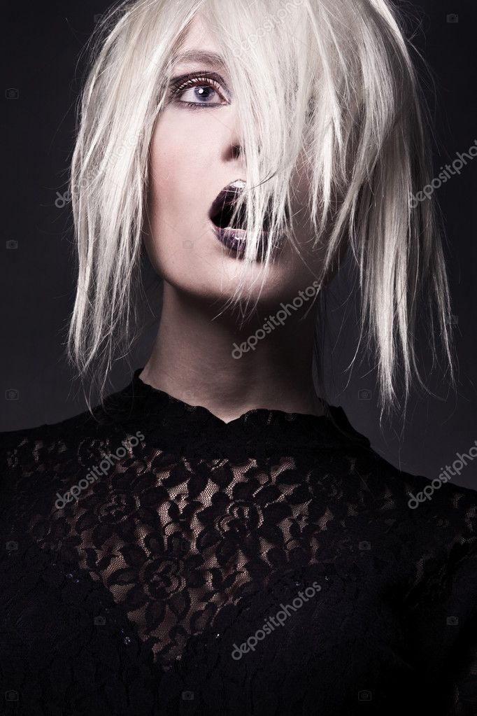 Young woman-witch in a vampire look  Stock Photo #3357845