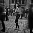 Fine art photo - topless brunette startled in the street crowd — Stock Photo