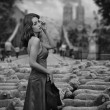 Fine art photo - brunette as a shepherd in an urban scenery — Stock Photo