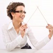 Young businesswoman holding a triangle symbol — Stock Photo
