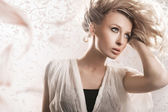 Young blond beauty with creativity hairstyle — Stock Photo