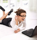 Happy young businesswoman with laptop on the floor — Foto de Stock