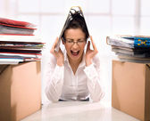 Young businesswoman in stress — Stockfoto