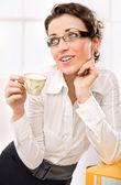 Attractive secretary drinking coffee — Stock Photo