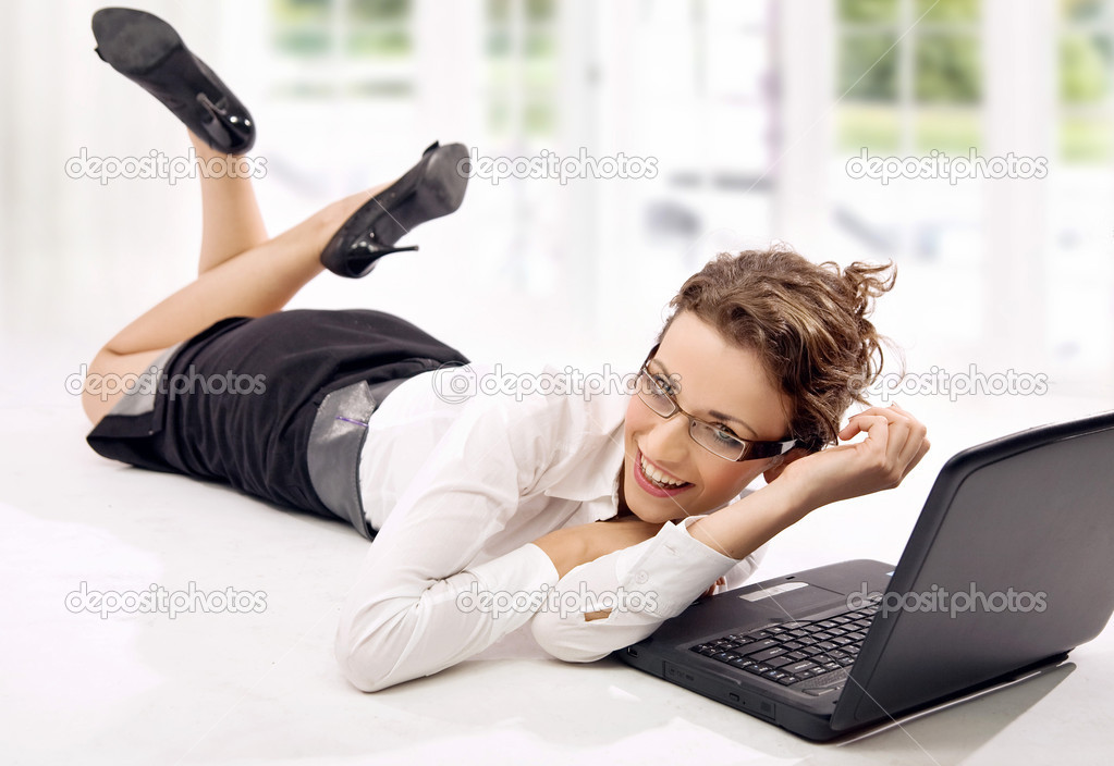 Happy young businesswoman with laptop on the floor — Stock Photo #4267445