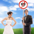Symbolic wedding picture - don't break my heart! - Stock Photo