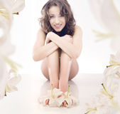 Legs of beautiful girl with lily — Stock Photo