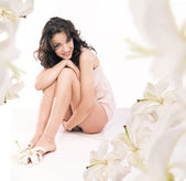 Young woman in white flowers — Stock Photo