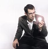 Businessman holding a light bulb — Stock Photo