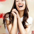 Close up portrait of cheerful young woman — Stockfoto