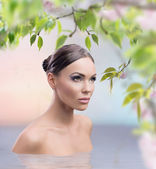 Spring bath of a stunning female beauty — Stock Photo
