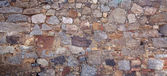 Real wall made of stones — Stock Photo