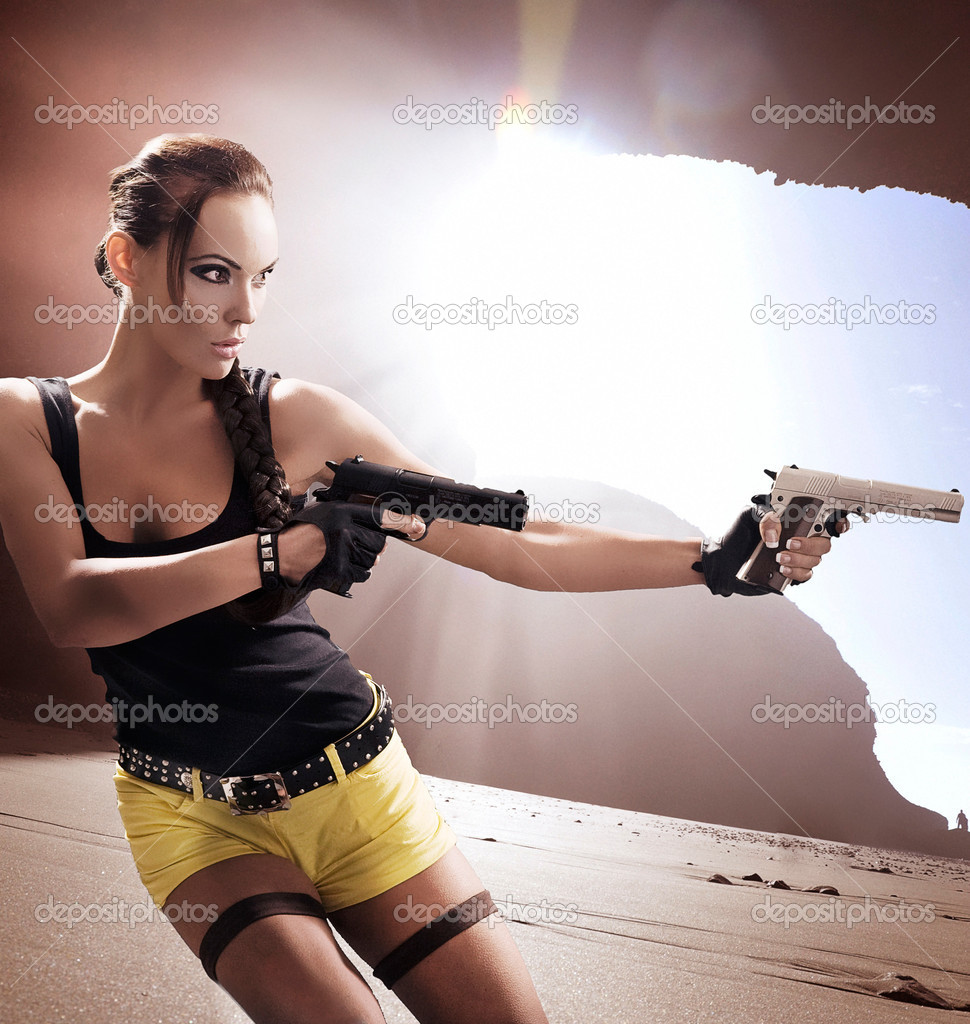 Lara croft in action  Stock Photo #4293039