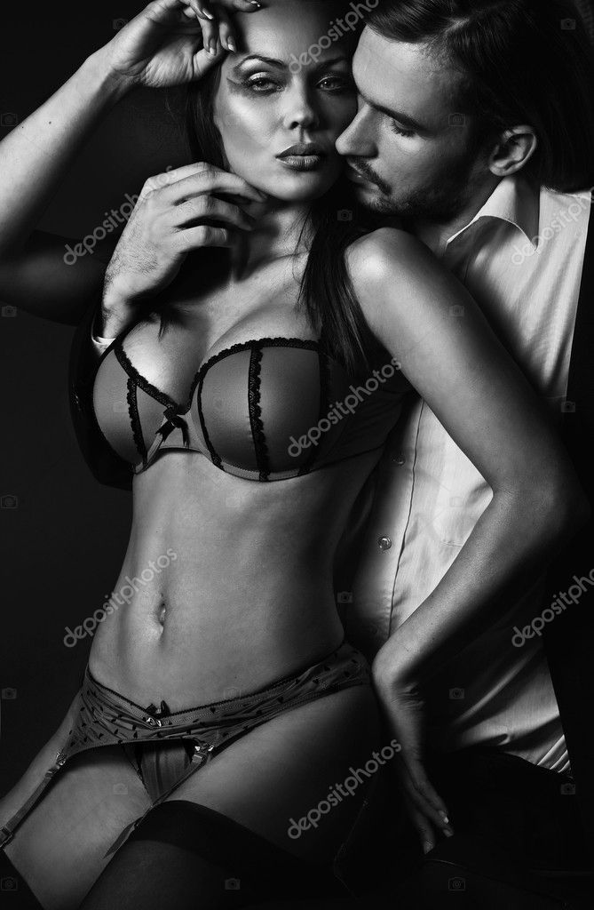 Attractive sexy couple in dark room   Stock Photo #4293083