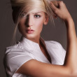 Attractive blonde in a vogue style pose — Stock Photo #4308268