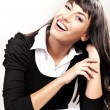 Happy young woman smiling - Stockfoto