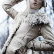 Portrait of an attractive girl wearing white fur - Foto Stock