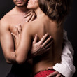 Emotive portrait of a young sexy couple — Stock Photo