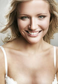 Portrait of a smiling blonde — Stock Photo