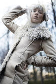 Portrait of an attractive girl wearing white fur — 图库照片