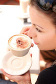 Young woman enjoying coffee break — Stock Photo
