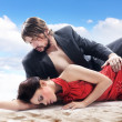 Attractive couple on the beach — Stock fotografie