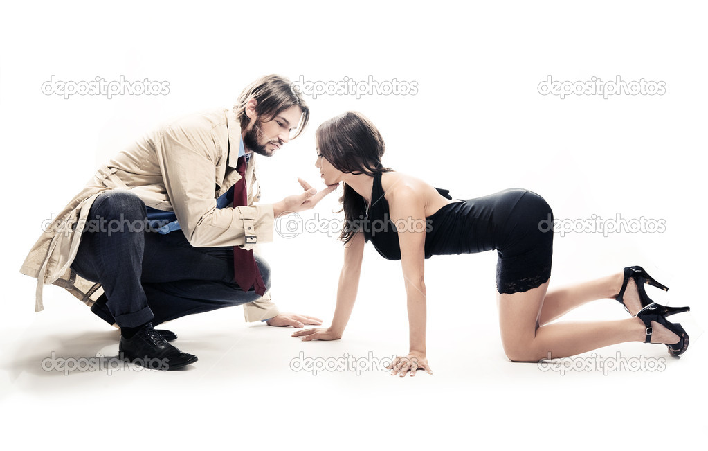 An attractive man and woman in frivolous pose, isolated on white  — Stock Photo #4468336