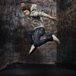 Young hip-hop dancer over a grunge wall — Stock Photo