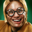 Funny guy grimacing over green background - Stok fotoraf