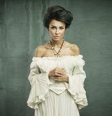 Young woman wearing beautiful dress — Stock Photo