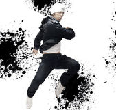 Hip Hop dancer jumping, over abstract splash background — Stock Photo
