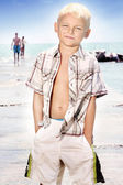 Young boy posing on the beach — Stock Photo
