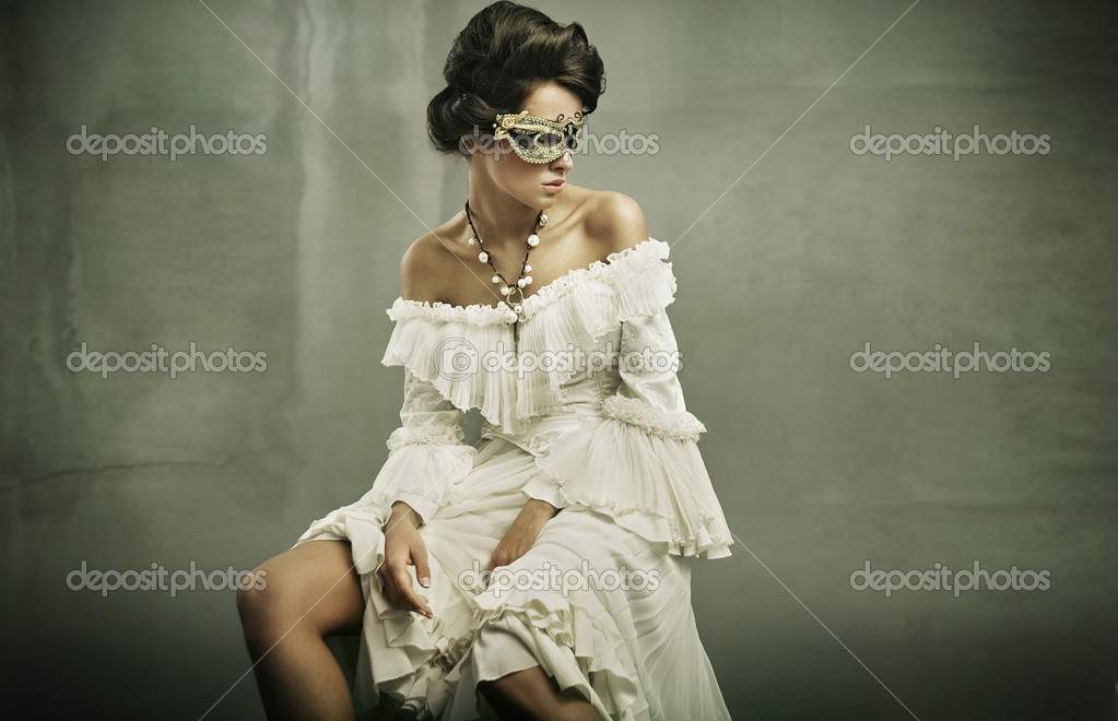 Fine art photo of a young woman wearing mask  — Stock Photo #4489659