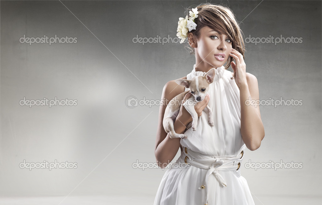 Elegant woman holding a small dog  — Stock Photo #4489668