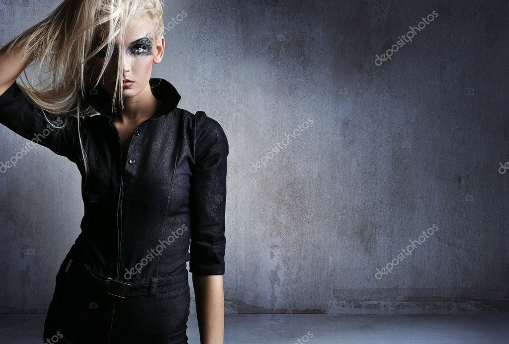Young woman in a vampire look over grunge background   Stock Photo #4489877