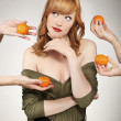Stock Photo: Beautiful wommaking fruit choice