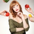 Stock Photo: Beautiful wommaking vegetable choice