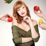 Beautiful woman making a vegetable choice — Stock Photo